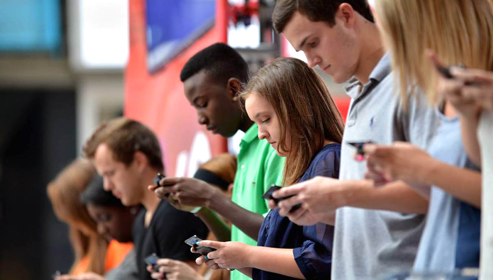 Teenagers on cell phone