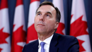 FILE PHOTO: Canada's Finance Minister Bill Morneau listens to a question during a news conference about the state of the Kinder Morgan pipeline expansion in Ottawa, Ontario, Canada, May 16, 2018. REUTERS/Chris Wattie/File Photo