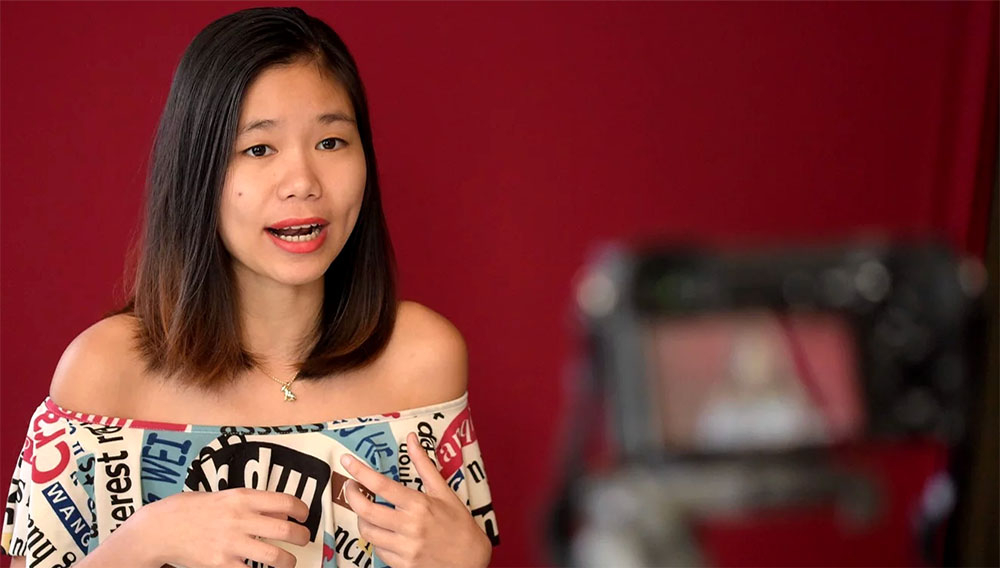 The 23-year-old Cambodian blogger, using the pen name Catherine Harry, records a video for her blog in her Phnom Penh studio. Photo: AFP