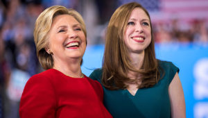 Hillary Clinton and Chelsea Clinton attend a rally in Raleigh, North Carolina, on November 8, 2016. Brooks Kraft/Getty Images