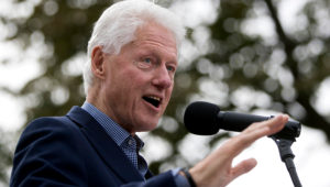 Former President Bill Clinton campaigning for his wife, Democratic presidential candidate Hillary Clinton, in October. (AP Photo/John Minchillo, File)