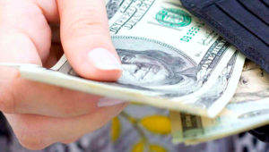 Woman paying money. Pinsdaddy