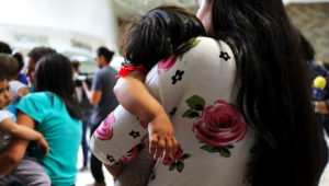 Dozens of migrant women and their children arrive at a bus station in McAllen, Texas, following their release by Customs and Border Protection last month. Spencer Platt/Getty Images