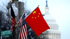 The People's Republic of China flag and the U.S. Stars and Stripes fly on a lamp post along Pennsylvania Avenue near the U.S. Capitol during Chinese President Hu Jintao's state visit, in Washington, D.C., U.S., January 18, 2011. REUTERS/Hyungwon Kang/File Photo
