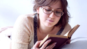 Woman reading book.