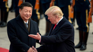 China's President Xi Jinping (L) and US President Donald Trump attend a welcome ceremony at the Great Hall of the People in Beijing on November 9, 2017. (FRED DUFOUR/AFP/Getty Images)