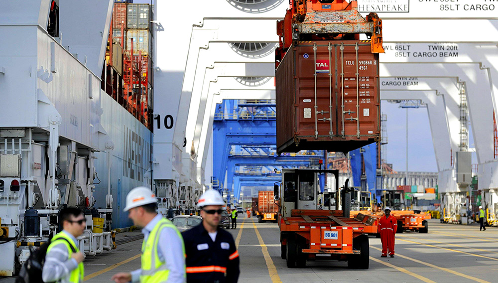 In this Oct. 24, 2016, photo, a container is unloaded from a ship at the Port of Baltimore in Baltimore. On Wednesday, Sept. 6, 2017, the Commerce Department reports on the U.S. trade gap for July. (AP Photo/Patrick Semansky)
