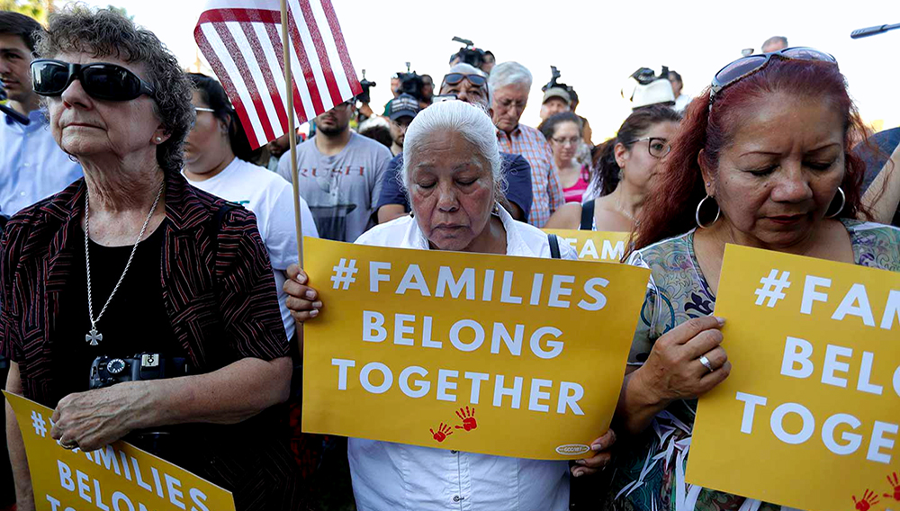 """Protesters pray during a Rally for Our Children event to protest a new """"zero-tolerance"""" immigration policy that has led to the separation of families. (AP Photo / Eric Gay)"""