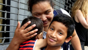 In this Friday, Aug. 3, 2018 file photo, Honduran Nahun Eduardo Puerto Pineda, then 8, holds his 2-year-old sibling after being reunited with his mother, Eilyn Carbajal, at the Cayuga Center, in New York. Fearful immigrant families hoping to reunite with children and teenagers who crossed the border alone are facing an intimidating system that includes submitting fingerprints by all adults in the household where a migrant child will live. Under new rules, the finger prints are shared with Immigration and Customs Enforcement. (AP Photo/Richard Drew)