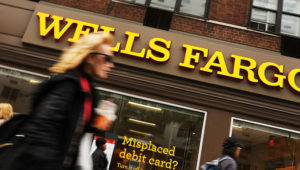 People walk by a Wells Fargo bank branch on October 13, 2017, in New York City. Spencer Platt/Getty Images