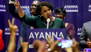 Boston City Councilor Ayanna Pressley celebrates her victory Tuesday over Rep. Michael Capuano in the Democratic primary for the state's 7th District congressional seat. Steven Senne / AP