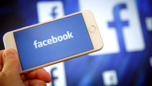 The Facebook logo is seen on an Apple iPhone in this photo illustration on Aug. 28, 2017. Jaap Arriens—NurPhoto via Getty Images