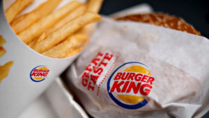 A Burger King Whopper hamburger is arranged with french fries for a photograph in Tiskilwa, Illinois, U.S., on Wednesday, Feb. 13, 2013. Burger King Worldwide Inc., the second largest fast food hamburger chain in the world, is scheduled to release quarterly earnings on Feb. 15. Photographer: Daniel Acker/Bloomberg via Getty Images