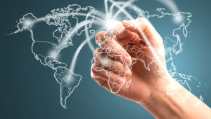 Businessman touching network around the world with logistic way. Photo: 123rf.com
