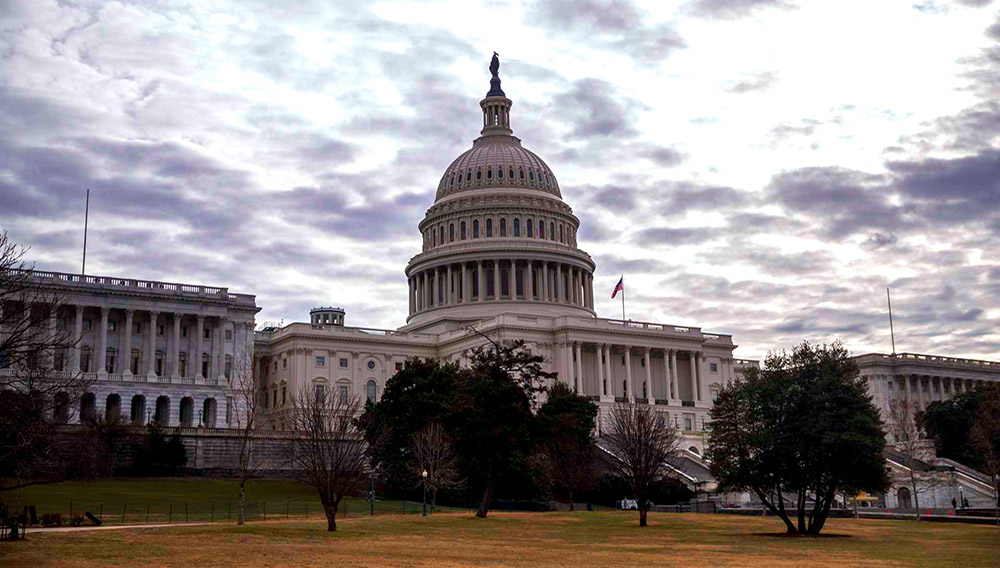 The US Capitol as the Senate continues work on ending the government shutdown in Washington, DC, USA, 22 January 2018. The Senate is negotiating and set to vote at noon on the latest continuing resolution in hopes to end the shutdown. EPA/SHAWN THEW