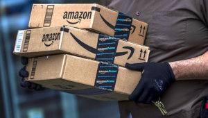 A United Parcel Service delivery driver carries Amazon.com packages in Brooklyn, N.Y. Victor J. Blue   Bloomberg   Getty Images