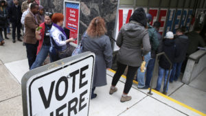 Some voters in Minneapolis took advantage of the last day of early voting on Monday. JIM MONE / AP