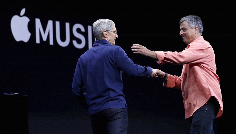 Apple CEO Tim Cook, left, greets senior vice president of internet services and software Eddy Cue. Robert Galbraith   Reuters