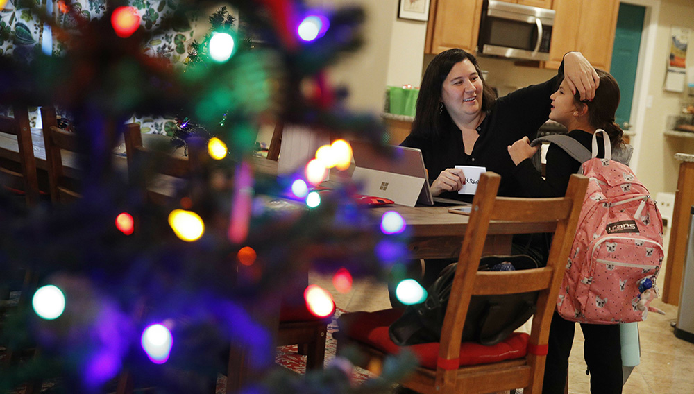 Rochelle Thuy Nguyen greets her daughter Hannah Lay at their home, Tuesday, Dec. 18, 2018, in Las Vegas. Nevada became the first state in the U.S. with an overall female majority in the Legislature on Tuesday when county officials in Las Vegas appointed Nguyen and another women to fill vacancies in the state Assembly. (AP Photo/John Locher)