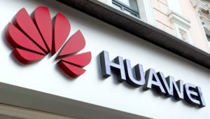 Huawei logo seen at the entrance to a Huawei brand store in Kiev, Ukraine. Credit: Pavlo Gonchar/SOPA Images/ZUMA Wire/Alamy Live News