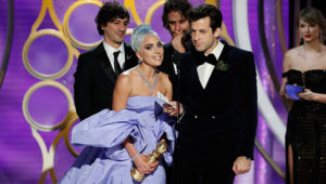 """BEVERLY HILLS, CALIFORNIA - JANUARY 06: In this handout photo provided by NBCUniversal, Lady Gaga and Mark Ronson accept the Best Original Song - Motion Picture awards for """"Shallow"""" from """"A Star Is Born"""" onstage during the 76th Annual Golden Globe Awards at The Beverly Hilton Hotel on January 06, 2019 in Beverly Hills, California. (Photo by Paul Drinkwater/NBCUniversal via Getty Images)"""
