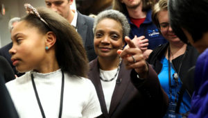 Mayoral candidate Lori Lightfoot and her daughter Vivian Lightfoot appear with supporters at EvolveHer in Chicago Tuesday, Feb. 26, 2019. Former federal prosecutor Lightfoot, who could become the first African-American woman to lead the nation's third-largest city, was the top vote-getter in a field of 14 that included a member of the Daley family that has dominated Chicago politics for much of the last six decades. (Erin Hooley/Chicago Tribune via AP)