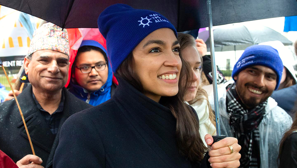 Alexandria Ocasio-Cortez arrives to speak during the March For TPS Justice rally in support of DACA recipients and temporary protected status holders as demonstrators protest for permanent residency outside the White House in Washington, DC, February 12, 2019. SAUL LOEB/AFP/GETTY IMAGES