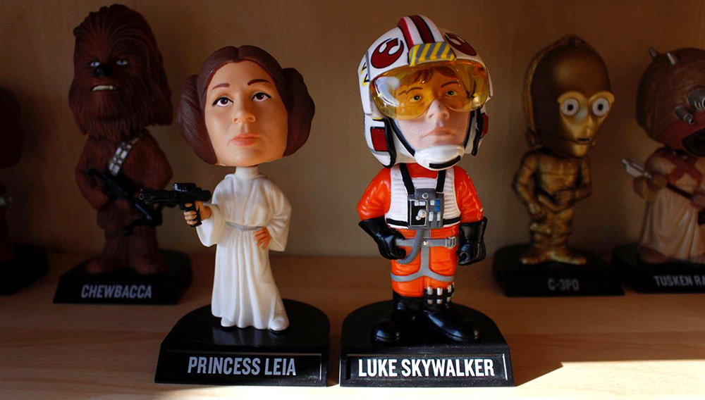 """In this Jan. 8, 2019 photo, bobbleheads from the """"Star Wars"""" movies are displayed at National Bobblehead Hall of Fame and Museum in Milwaukee. The new museum will have on view more than 6,500 figures of athletes, mascots, celebrities, animals, cartoon characters, politicians and more. (AP Photo/Carrie Antlfinger)"""