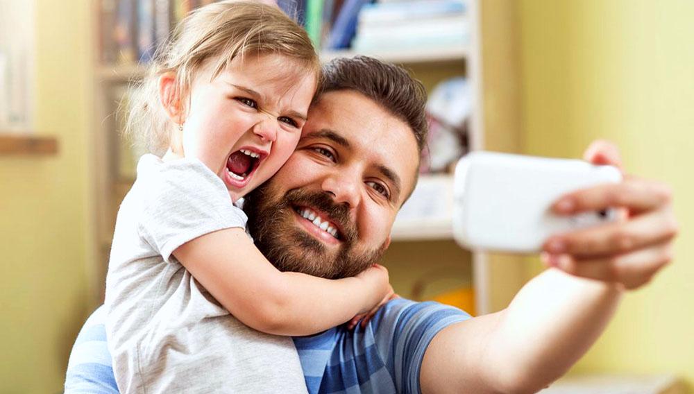 Dad daughter selfie. Shutterstock.