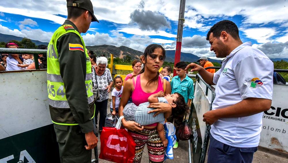 Cruzar tres países y tomar 13 buses, el precio por huir de Venezuela. Foto: AFP