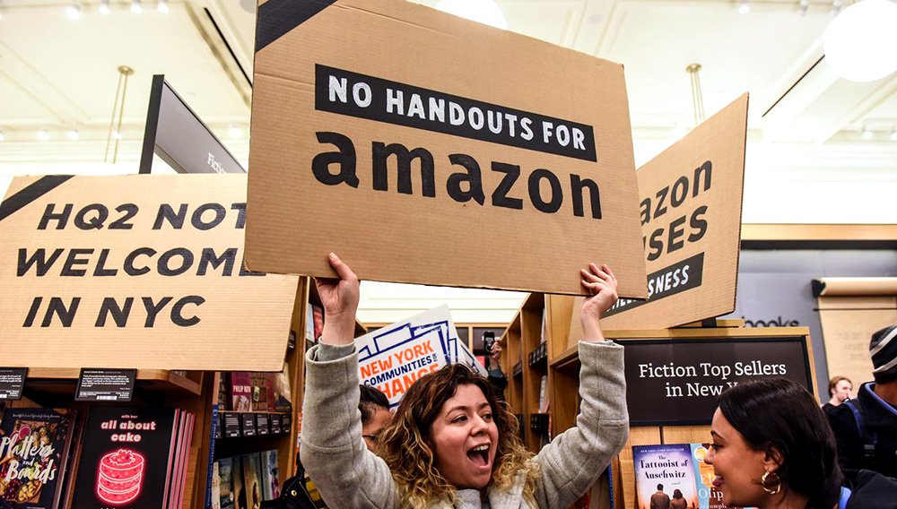 People opposed to Amazon's plan to build a second headquarters in New York hold a protest inside of an Amazon book store in Manhattan on November 26, 2018. Amazon has since scrapped its plan to build a Queens campus. Stephanie Keith/Getty Images