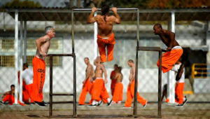 Inmates at Chino State Prison exercise in the yard December 10, 2010 in Chino, California. (Photo by Kevork Djansezian/Getty Images)