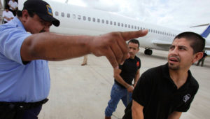 Shackled Mexican immigrants are directed by a guard to a waiting deportation by the U.S. Immigration and Customs Enforcement in Harlingen, Texas. (AP)