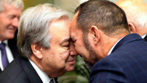 United Nations Secretary-General, Antonio Guterres, left, receives a hongi from Arapata Reuben on his arrival at a climate change and agriculture event hosted by Ngai Tahu iwi and the Global Research Alliance on Agricultural Greenhouse Gases in Christchurch, New Zealand, Tuesday, May 14, 2019.