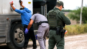 Border Patrol agents apprehend illegal aliens who have just crossed the Rio Grande from Mexico into Penitas, Tex., on March 21, 2019. (Charlotte Cuthbertson/The Epoch Times)