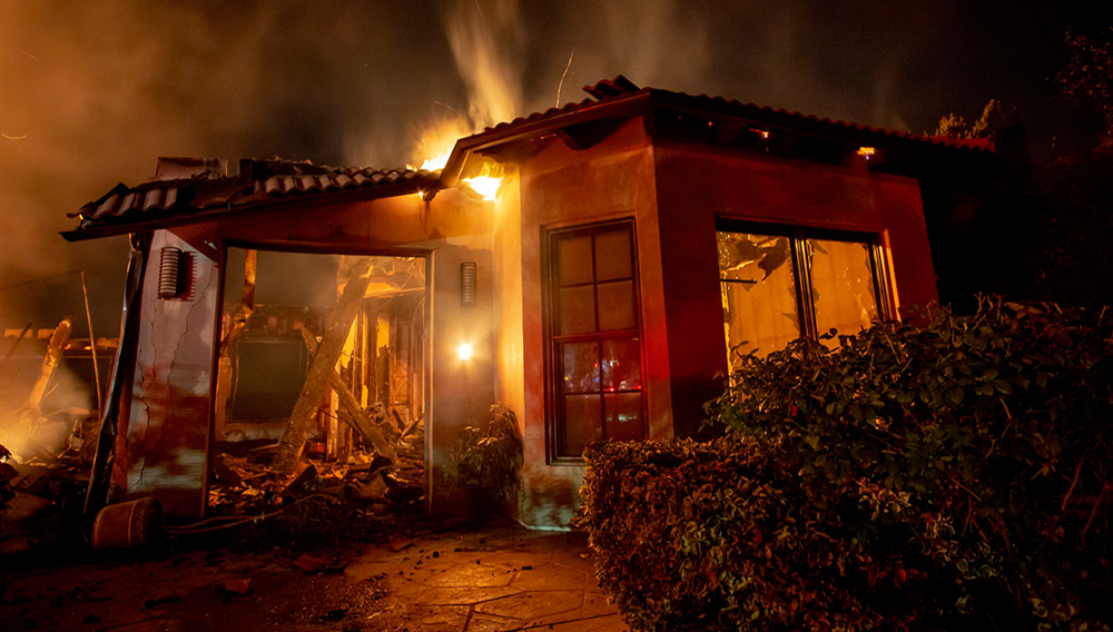 WEST HILLS, CALIFORNIA - NOVEMBER, 9: A house burns during the Woolsey Fire. | Kyle Grillot Photography