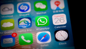 This photo illustration shows the Whatsapp application logo (C) on a smartphone screen in Beijing on September 26, 2017. / AFP PHOTO / NICOLAS ASFOURI (Photo credit should read NICOLAS ASFOURI/AFP/Getty Images)