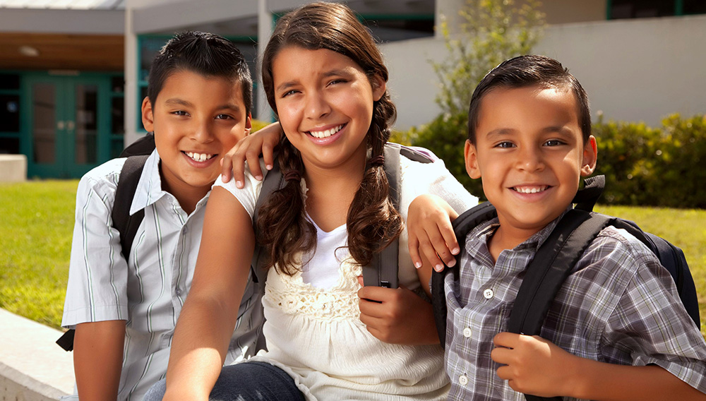 Cute Brothers and Sister Ready for School.   Andy Dean Photography (Photostock)