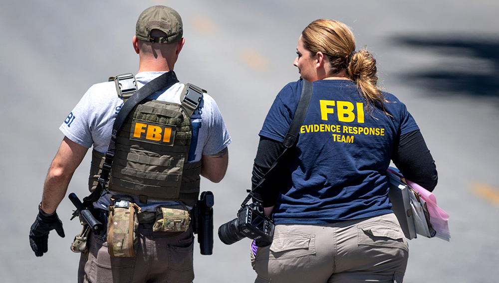 Law enforcement officers from multiple agencies come and go from the scene on July 29, 2019 where four people were killed and another 15 injured during the Gilroy Garlic Festival in Calif. RON HOLMAN, USA TODAY NETWORK