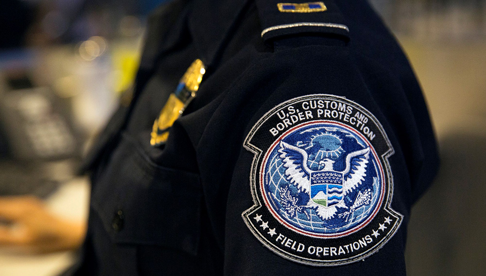 Officers with the U.S. Customs and Border Protection, Office of Field Operations, process international arrivals of passenger flights at Boston Logan International Airport June 21, 2017 in Boston, Mass. | Photo: U.S. Customs and Border Protection / Glenn Fawcett