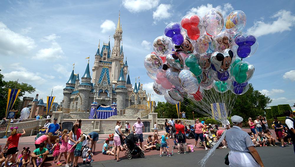 A cast member sells balloons in front of Cinderella Castle at Walt Disney World's Magic Kingdom theme park in Lake Buena Vista, Fla., Saturday, May 10, 2014. | AP Photo/Phelan M. Ebenhack