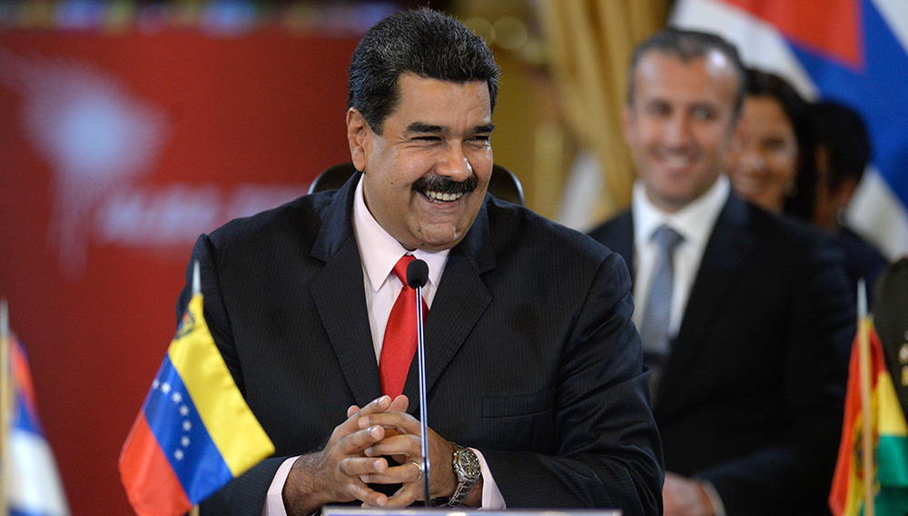 Venezuelan President Nicolas Maduro smiles while giving a speech during the Bolivarian Alliance for the Peoples of Our America (ALBA) summit at the Miraflores presidential palace in Caracas on March 5, 2017. | PHOTO: FEDERICO PARRA/AFP/Getty Images)
