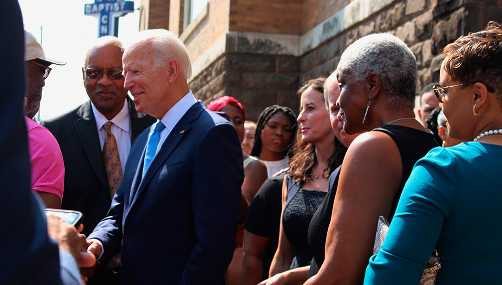 Former Vice President and presidential candidate Joe Biden, center, left, speaks with an attendee as he joins Sen. Doug Jones and Birmingham Mayor Randall Woodfin at a wreath laying after a service at 16th Street Baptist Church in Birmingham, Ala., Sunday, Sept. 15, 2019. Ivana Hrynkiw—The Birmingham News via AP