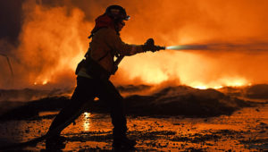 KNIGHTSEN, CA - OCTOBER 27: Firefighters battle a grass fire on East Cypress Road in Knightsen, Calif., on Sunday, Oct. 27, 2019. The grass fire originated 3:08 am on Gateway Blvd. on Bethel Island as reported by the East Contra Costa Fire Department. The fire then spread to a second location on East Cypress Road at 5:45 am. (Jose Carlos Fajardo/Bay Area News Group)