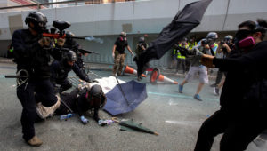A riot police officer fires pepper-spray projectile toward anti-government protesters demonstrating near the Legislative Council building in Hong Kong, China, September 29, 2019. | REUTERS/Athit Perawongmetha