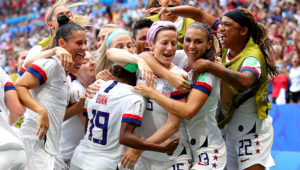 Megan Rapinoe of the USA celebrates with teammates after scoring her team's first goal during the 2019 FIFA Women's World Cup France Final match between The United States of America and The Netherlands at Stade de Lyon on July 07, 2019 in Lyon, France. (Photo by Richard Heathcote/Getty Images)