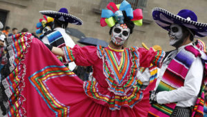 """Performers in costume attend a Day of the Dead parade in Mexico City, Sunday, Oct. 27, 2019. The parade on Sunday marks the fourth consecutive year that the city has borrowed props from the opening scene of the James Bond film, """"Spectre,"""" in which Daniel Craig's title character dons a skull mask as he makes his way through a crowd of revelers. Photo: Ginnette Riquelme, AP"""