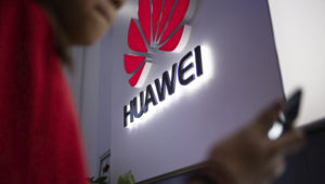 A Huawei logo is displayed at a retail store in Beijing, China on May 27, 2019. Fred Dufour—AFP/Getty Images