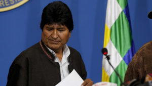Bolivia's President Evo Morales looks down during a press conference in La Paz, Bolivia, Sunday, Nov. 10, 2019. Morales is calling for new presidential elections and an overhaul of the electoral system Sunday after a preliminary report by the Organization of American States found irregularities in the Oct. 20 elections. (AP Photo/Juan Karita)