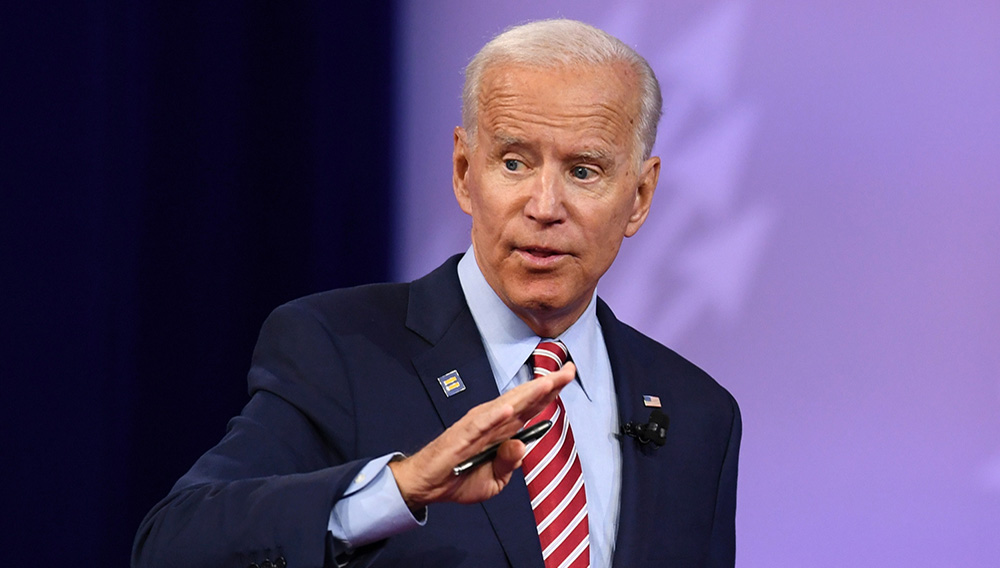 Democratic presidential hopeful former US Vice President Joe Biden gestures as he speaks during a town hall devoted to LGBTQ issues hosted by CNN and the Human rights Campaign Foundation at The Novo in Los Angeles on October 10, 2019. Photo credit: ROBYN BECK/AFP/Getty